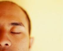 Man Closing Eyes